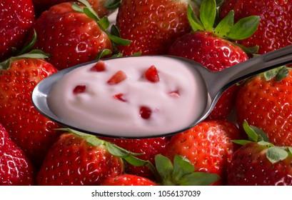 strawberry yogurt cream spoon with strawberry fruit pieces on