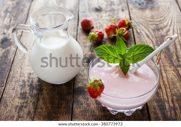 strawberry yogurt and milk on a table, selective focus