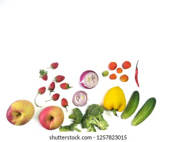 strawberry,apple,sweet pepper,onion,cucumber,tomato,chilli,broccoli isolated on white background.