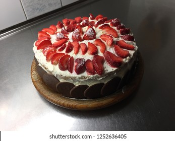 Strawberrycake, birthdaycake homemade in summertime. Celebration.