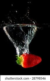 strawberrys splashing in fresh water showing healthy lifestyle