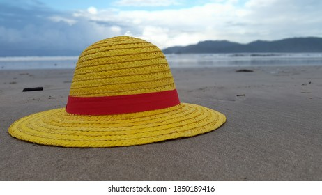 Strawhat at the beach in sunrise