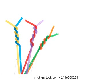Straws in LGBT rainbow colors on white.
