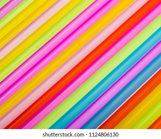 Straws of multiple colors in an angled line