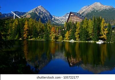 Strbske pleso. High tatras mountains. Vysoke tatry. Autumn forest. Reflection in lake. Beautiful landscape. Slovakia. Hotel Patria