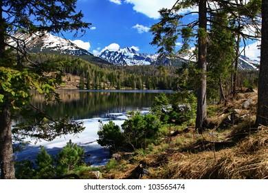 Strbske pleso. High Tatras. Vysoke Tatry. Mountains landscape. Slovakia. Waterscape. Forest and lake.