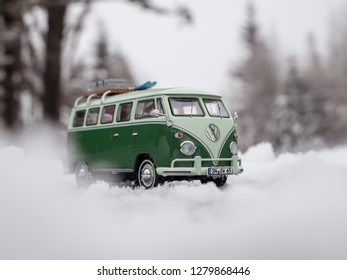 STRBSKE PLESO, SLOVAKIA - JANUARY 08 2019: Scale model Volkswagen Transporter T1 / Volkswagen T1 / Volkswagen Bus / Volkswagen Bulli with skis and luggage on the roof rack on snowy road.
