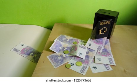 "stream of banknotes and coins leaving ""safe"" vault in bank, financial concept of possible fraud or swindle with client's money by financial institution, money from Czech Republic (Central Europe, CZK)"