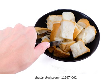 STREAM BREAD IN BLACK BOWL ON WHITE BACKGROUND AND LEFT HAND WITH TONGS