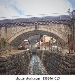 Stream and bridge in Cavalese, Italy