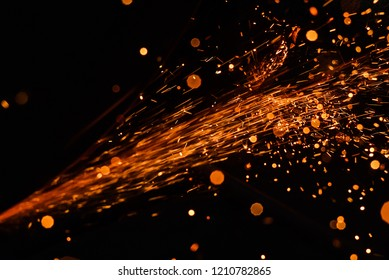 A stream of bright sparks from metal cutting.