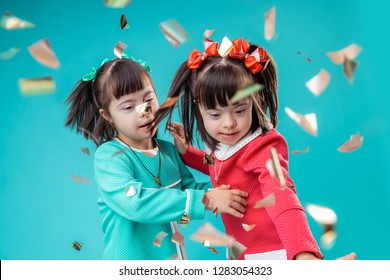 Stream of confetti. Curious little ladies moving together while papers falling all over room