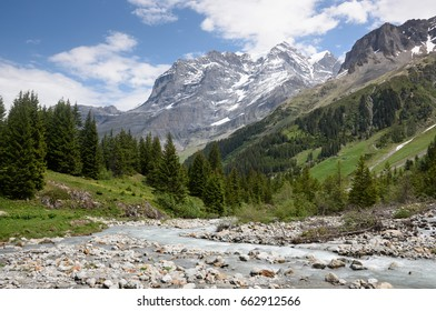 The stream flowing down the upper Lauterbrunnen Valley, Switzerland, showing the western side of the Jungfrau in the distance.