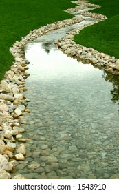 Stream flowing downward in green nature