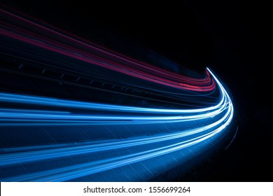 Stream of light trails on motorway at night
