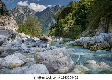Stream (Lumi i Zi) near Blue Eye lake in the Albanian Alps, Theth National Park.