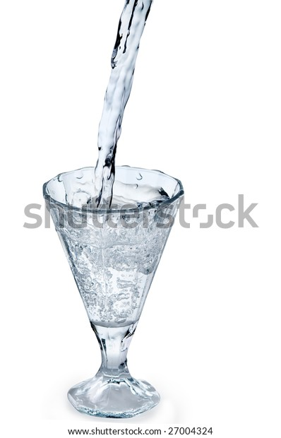 Stream of pouring water into a glass isolated over white background