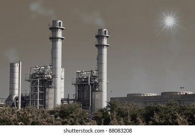 Stream power plant with sun and blue sky.