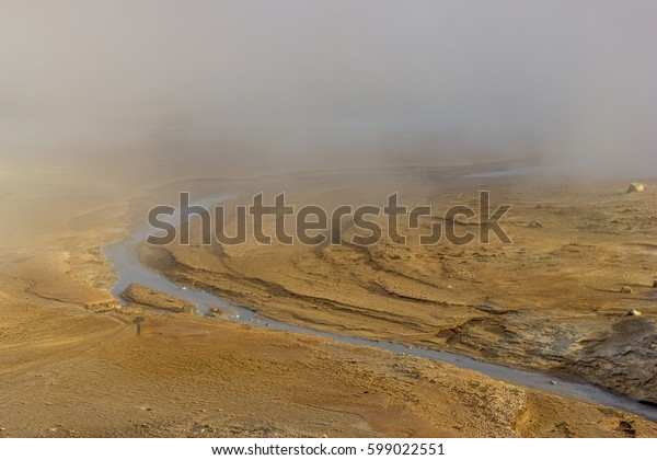 A stream running through the cloud of geothermal steam