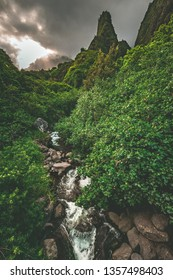 A stream runs through the lush rainforest jungle beneath the Iao Needle in Iao Valley State Park outside of Kahului and Wailuku in the West Maui Forest Preserve on the island of Maui, hawaii, USA.
