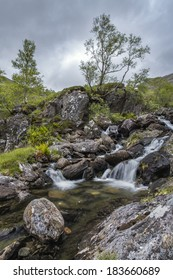 A stream with small waterfall during a weather change near Fort William and Glenn Nevis.