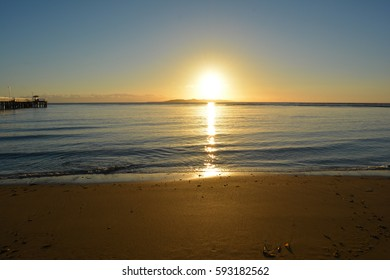 A stream of sunlight rising over the ocean