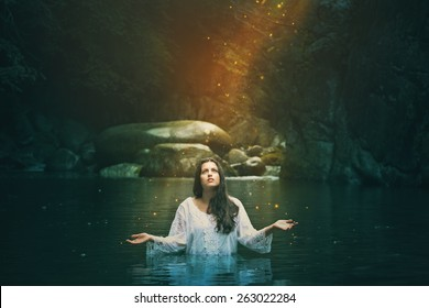 Stream water nymph among forest spirits . Fantasy and surreal