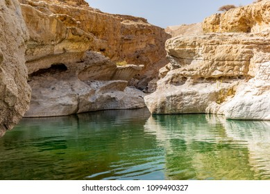 A stream of water in the rocky desert of Oman flowing in a canyon to the oasis of Wadi Bani Khalid - 6