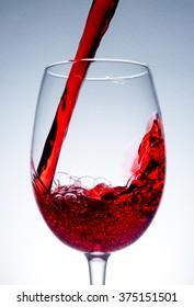 stream of wine being poured into a glass,  wine, splashing, splash,