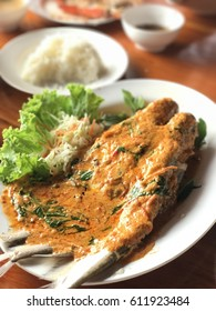 Streamed fish with red curry paste. Thai cuisine.