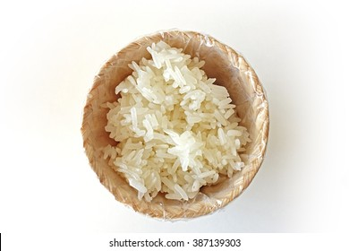 Streamed sticky rice in wicker basket isolated on white background. It is Thai's favorite menu which is widely spread across the country, especially having it with spicy menu. It is inevitable.