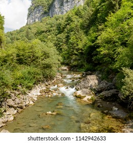 streaming clear waters of Dezzo creek, shot in bright summer light at Via Mala, Scalve canyon, Colere, Bergamo, Orobie, Lombardy, Italy