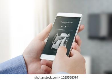 Streaming music application on smart phone. mobile phone music listening guitar album concept