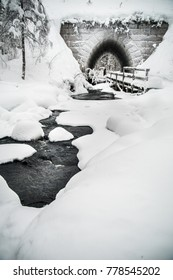 Streaming water from a fairy tale like magical tunnel. A real winter landscape.