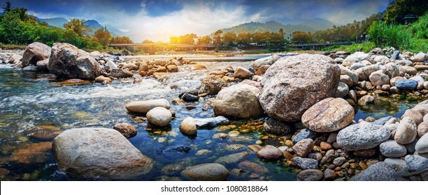 Streaming water and rocks in a small river , Ban Khiri Wong village, Nakhon Si Thammarat, Thailand, landscape and panorama shot.