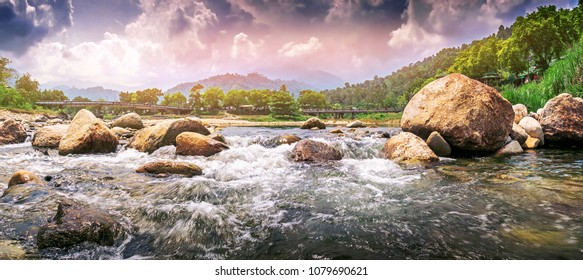 Streaming water in a small river , panorama shot