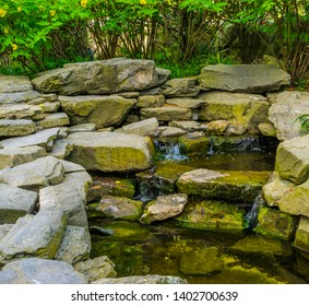 streaming waterfall made out of many rocks, tropical garden architecture