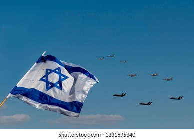 Streaming in the wind Israeli Flag and Military Defense Aircraft flying on blue sky on the Parade of Independence Holiday Day of Israel