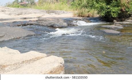 Streams and rocks in Kaeng Lan Nok Yoong at Nakhon Sawan, Thailand.