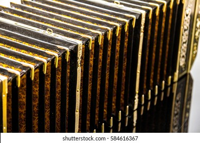 Streched Bandoneon on on the piano with reflection