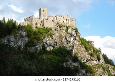 Strecno / Slovakia - July 15, 2006: The ruins of Strecno Castle overlooking the river Vah and the road from Zilina to Martin, July 15, 2006.