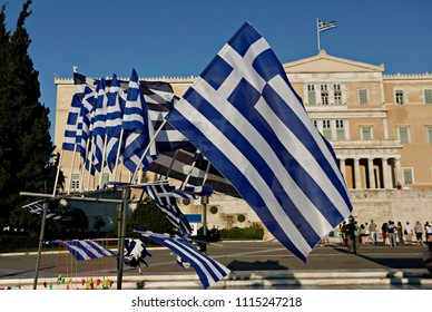 A streer vendor sells Greek flags in Athens, Greece on Jul. 15, 2015