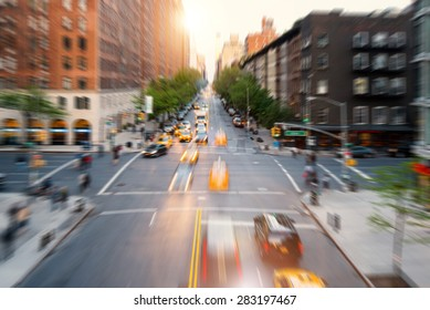 Street aerial view of midtown Manhattan with blurred moving cars. New York City. Radial zoom defocused editing. Rush lifestyle concept.