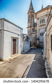 street in Alberobello village near Basilica of Saints Cosmas and Damian, Puglia, Italy