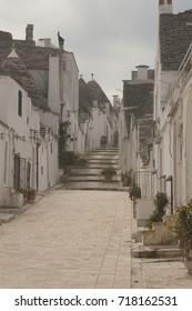Street of Alborobello town, Italy, region Puglia at winter season