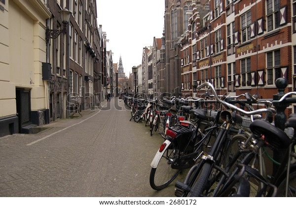 Street of Amsterdam with bikes parked along.