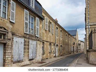 Street with ancient medieval historical buildings in old town of Poitiers, France