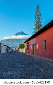 Street in Antigua city with Agua volcano, Guatemala.