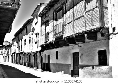 street, arcades, typical buildings, Berlanga de Duero, Soria, Spain, series of black and white artistic photographs,
