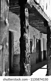 street, arcades, typical buildings, Berlanga de Duero, Soria, Spain, series of black and white artistic photographs